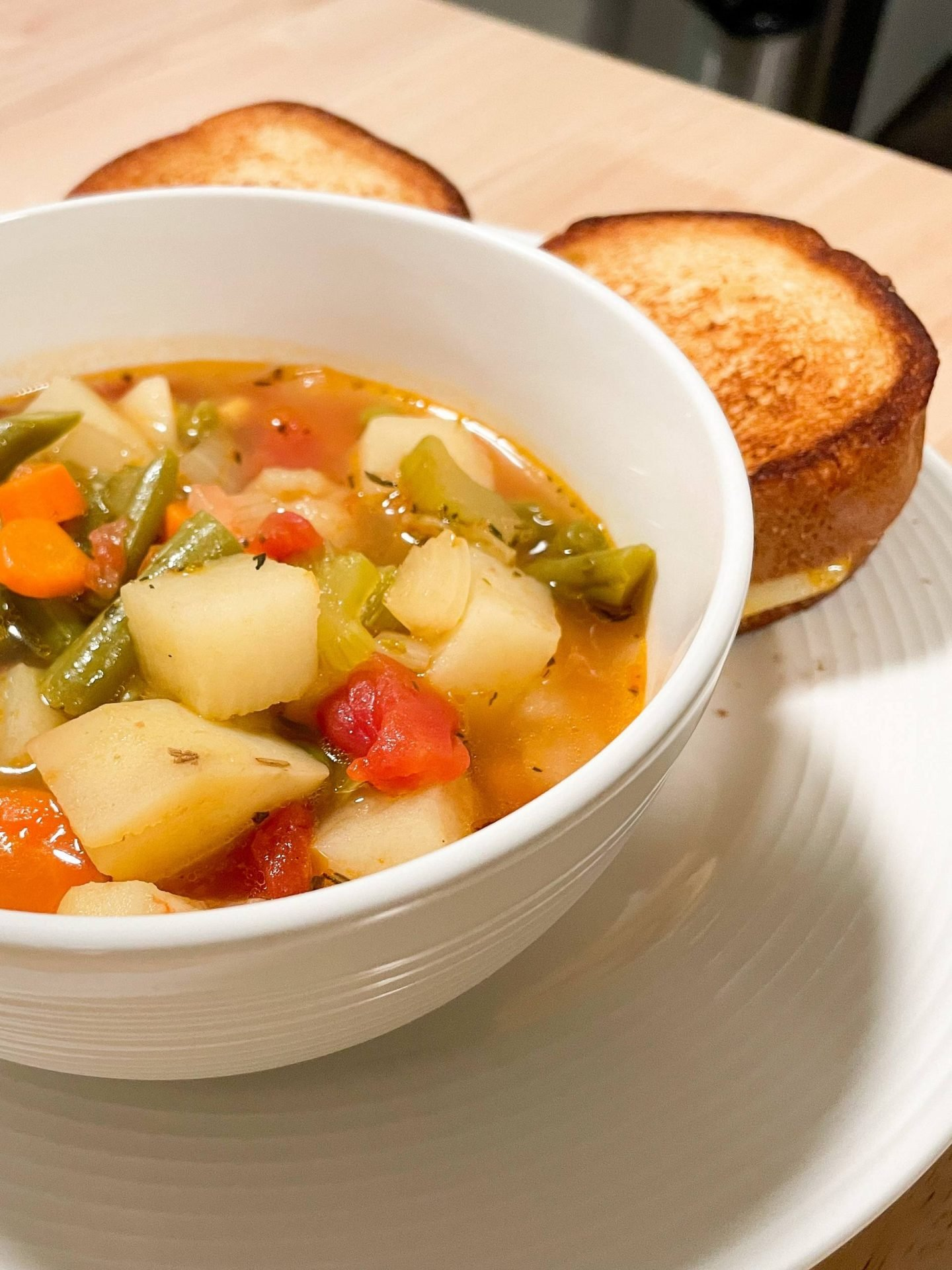 vegetable soup with grilled cheese sandwich photo